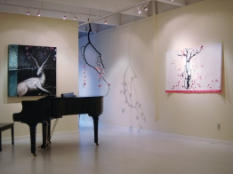 """Installation: painting on left by Julie Maren; center """"Pink Rain (mobile)"""" tree branch, paper, ink; right """"Pink Rain (scroll)"""", paper, fabric, ink, wood"""