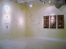 """Intallation: left, """"Bonsai"""" scrolls, center mobile from tree branch, gold paint, tea bags, right scrolls on vintage barkcloth"""