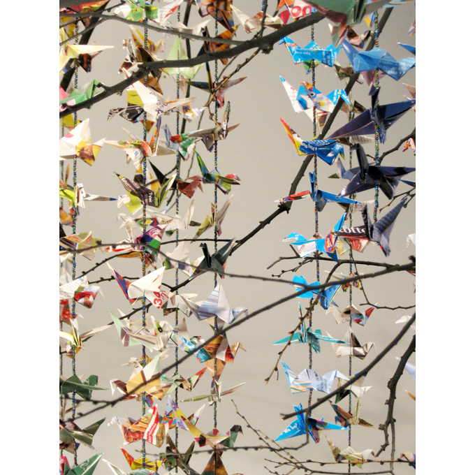 Phoenix (detail,) installation at the Art League in Houston, Texas, 2009, 1000 cranes folded from mail order catalogues, glass beads, found tree branch, black spray paint