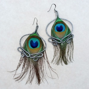 "Fountainebleau Earrings $47.50 Peacock feathers and steel approx. 2""w x 4""L"