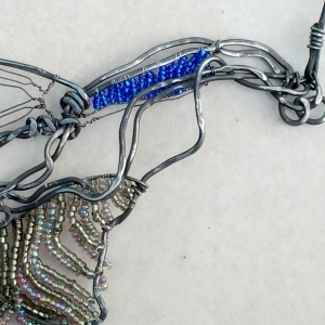 "Hummingbird Necklace (detail) One-of-a-kind $200 Steel, leather, glass beads 18"" L with 3.5"" bib"