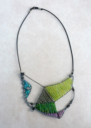 "Primavera Necklace One-of-a-kind $200 Steel, leather, glass beads 18"" L with 3.5"" bib"