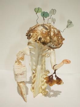 """Best Dressed,"" 5"" x 3"" x 3"", turkey bone, crab shells, modeling clay, sea weed, gauze, wire, beach glass, acrylic paint, 2004"