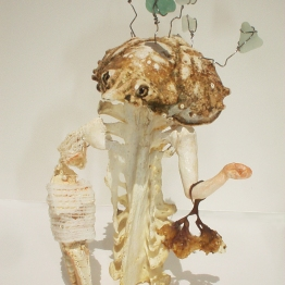 """Best Dressed,"" 5"" x 3"" x 3"", turkey bone, crab shells, modeling clay, sea weed, gauze, wire, beach glass, acrylic paint, 2004"